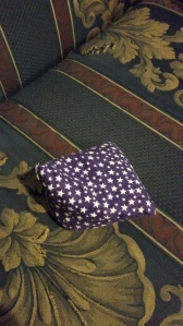 Image Description: small purple bean bag with white stars all over it, scented with lavender oil.