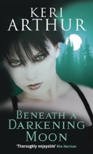 Image Description: book cover of Beneath A Darkening Moon by Keri Arthur