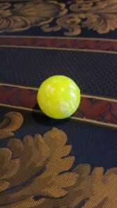 Image Description: a bright yellow bouncy ball