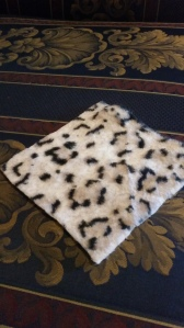 Image Description: a small diamond of soft fuzzy fabric