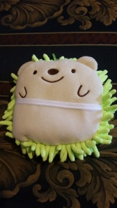 Image Description: Nubbly Hedgehog cleaning sponge (from Daiso) that's been filled with stuffing and scented with citrus-scented essential oil. It has an adorable little happy face