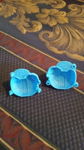 Image Description: two sky-blue moulds for fake kinetic sand