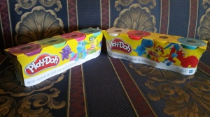 Image Description: two four packs of play-doh in multiple colours