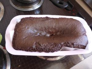 Image Description: a picture of a Devil's Food Cake (Betty Crocker version) inside of a light pink silicone loaf-tin