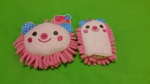 Image Description: Two pink sponges in the shape and form of pigs with pink fronds.