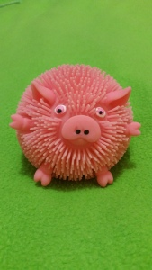 Image Description: A critter-puff in the shape of a pink pig.