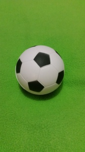 Image Description: a black and white patterned soccer-ball.
