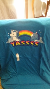 Image Description: A blue t-shirt with a unicorn and a narwhal posing in front of a rainbow with the word 'YASSSS' printed in rainbow text underneath them