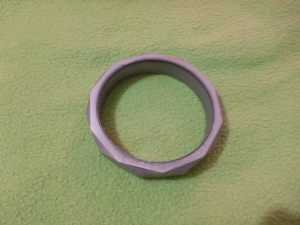 Image Description: silver chewable bangle bracelet