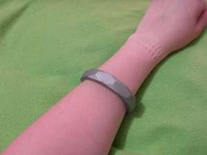 Image Description: silver chewable bangle bracelet on a white arm, pushed roughly half-way down the arm, this is as far as it can go on my arm