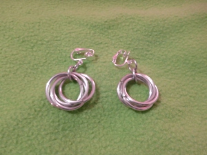 Image Description: Clip on earrings with silver color interlocking rings