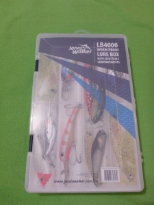 Image Description: a Jarvis Walker worm-proof lure-box with adjustable compartments. It also has pictures of various lures on the front of it.