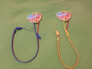 Image Description: from left to right, a blue and red zip-lanyard and a yellow and red zip-lanyard
