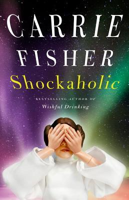 Image Description: the book-cover Shockaholic by Carrie Fisher. In the background is a light-pattern that resembles the Aurora borealis, in the foreground is a plastic doll of Princess Leia with the palms of her hands covering her eyes.