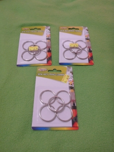Image Description: There are three packets of chrome coloured key-rings/split-rings, in each packet there are five key-rings/split-rings.