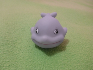 Image Description: a small squishable grey dolphin with eyeballs pointing in different directions.
