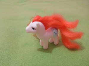 Image Description: a white and robin's egg-blue My Little Pony with blue eyes and bright-orange mane and tail.