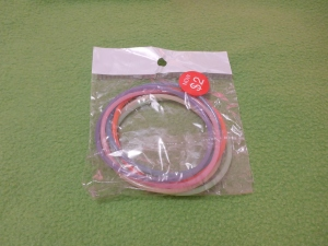 Image Description: a packet of thin rubber/silicone bracelets in multiple colours.