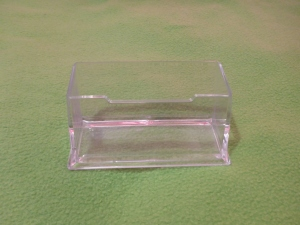 Image Description: a transparent plastic container used for holding business cards (or at least I think that's what it is).