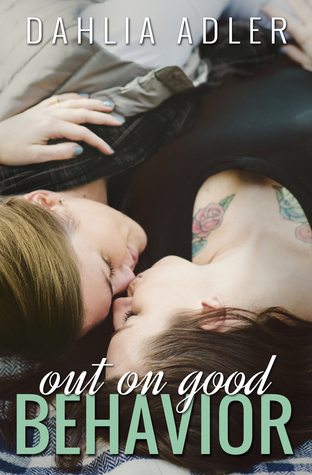 Image Description: The book cover of Out on Good Behaviour by Dahlia Adler. The cover has two white women with brown hair, cuddled up together, face to face, on a checked picnic blanket. The woman on the left is wearing a scarf and a coat, while the other woman is wearing a black shirt with plunging neck line that reveals two rose tattoos on both sides of her chest.