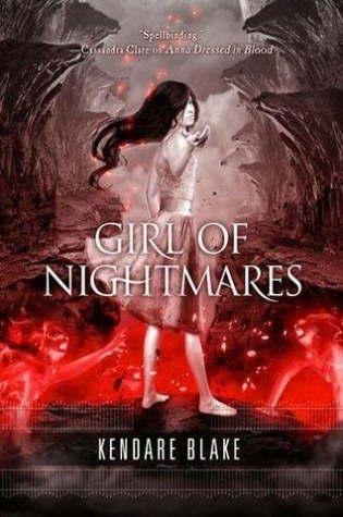 Image Description: book cover of Girl of Nightmares by Kendare Blake. In the foreground, a pale-skinned brunette young lady is extending out her hand towards the viewer. In the background is a mountainous landscape with a break in the ground, just before the young lady's feet, from within the large crack in the landscape is lava and red spirits coming out of the crack.