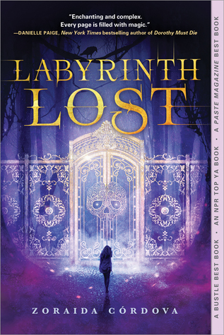 Image Description: book cover of Labyrinth Lost by Zoraida Cordova. The cover has a purple tint across entire cover, in the background is a golden gate with a skulls design within the entrance doors of the gate. In front of the gate is the silhouette a female figure, the female figure is standing in front of the gate with her back to the viewer.