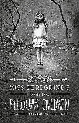 Image Description: book cover of Miss Peregrine's Home for Peculiar Children by Ransom Riggs. The cover is in black and white and the main image is of a small pale-skinned girl wearing a fancy head-piece and a fancy party dress, she appears to be hovering above the ground.
