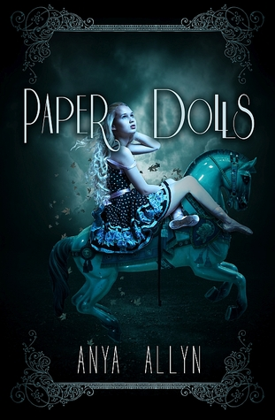 Image Description: book-cover of Paper Dolls by Anya Allyn. The cover image is colour scheme is dark-tinted, it features a pale-skinned young lady with blonde hair, she's wearing a black dress with white polka-dots, and she's sitting on a carousel-style blue horse.