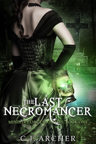 Image Description: book cover of The Last Necromancer by C.J. Archer. The background has a large stone cross and a graveyard. The foreground is a close-up picture of the back of a pale-skinned brunette woman wearing a black Victorian-style bodice dress, around her wrist is a latern with a skull inside it, the eyes of the skulls are green and glowing. There is a green tint across the cover.