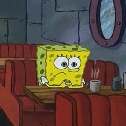 Image Description: a still image of Sponge-Bob Square-Pants sitting at a diner-style table and booth with a steaming cup of hot-drink in front of him.